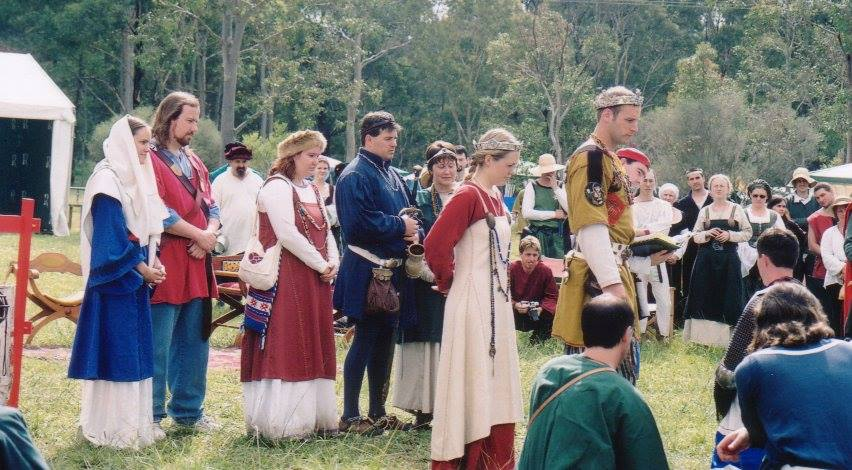 The first Rose Bag with it's maker, Lady Madeleine (third from the left in a red smokkr). Photo by Master John of the Hills, March 2002.