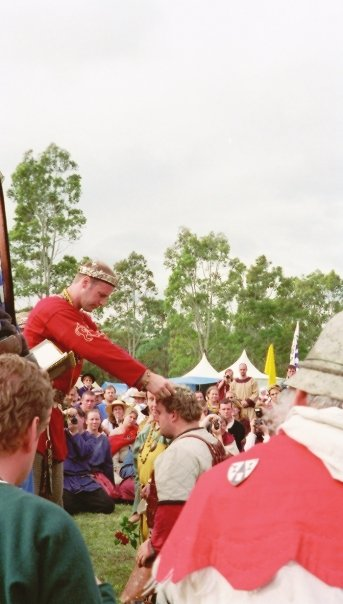 King Uther IV places the Wreath of Victory upon Alfar's head after winning Lochac's First Crown Tournament. Photo by Isobel Haverland of Heathpool, March 2002.